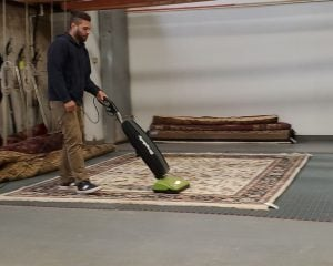 Vacuuming an Oriental Rug at Khouri's