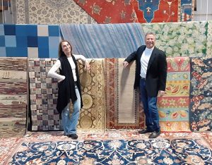 Joe and Marion with cascading oriental rugs